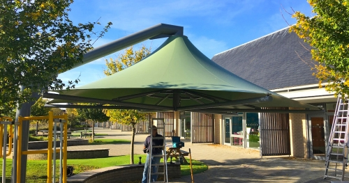 hanging construction big green shade sail