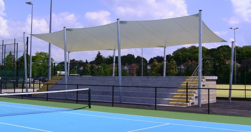 big white canopy on the tennis court