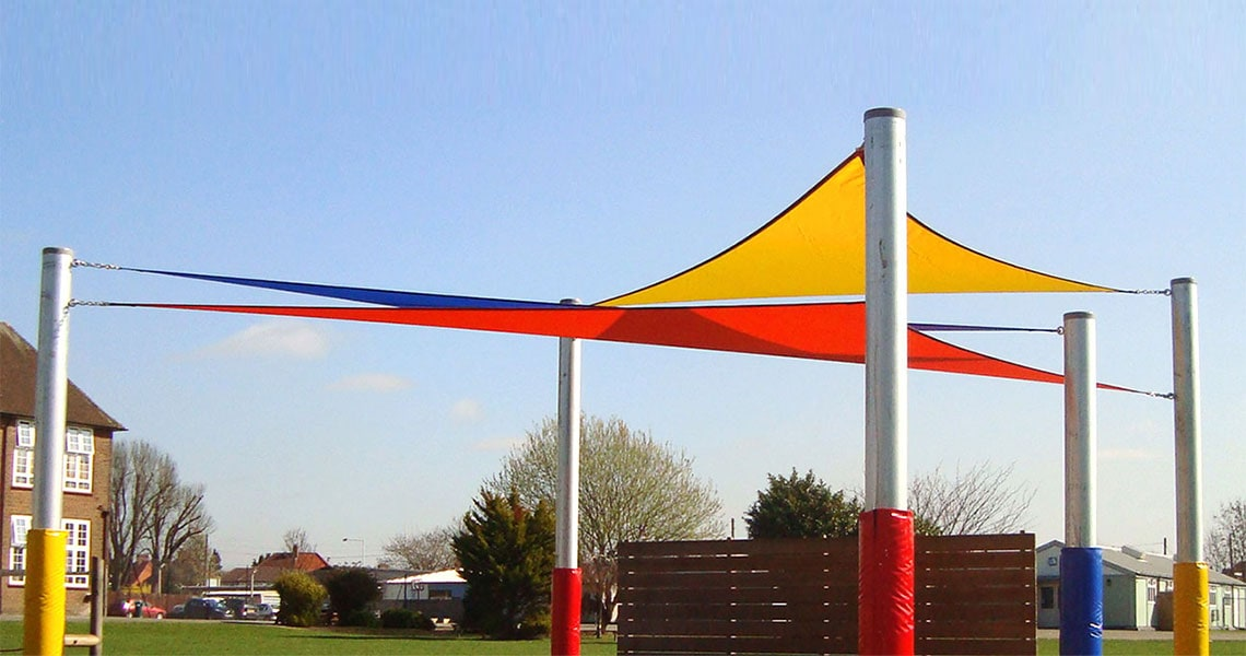 bespoke tensile shade sails in yellow, red, and blue