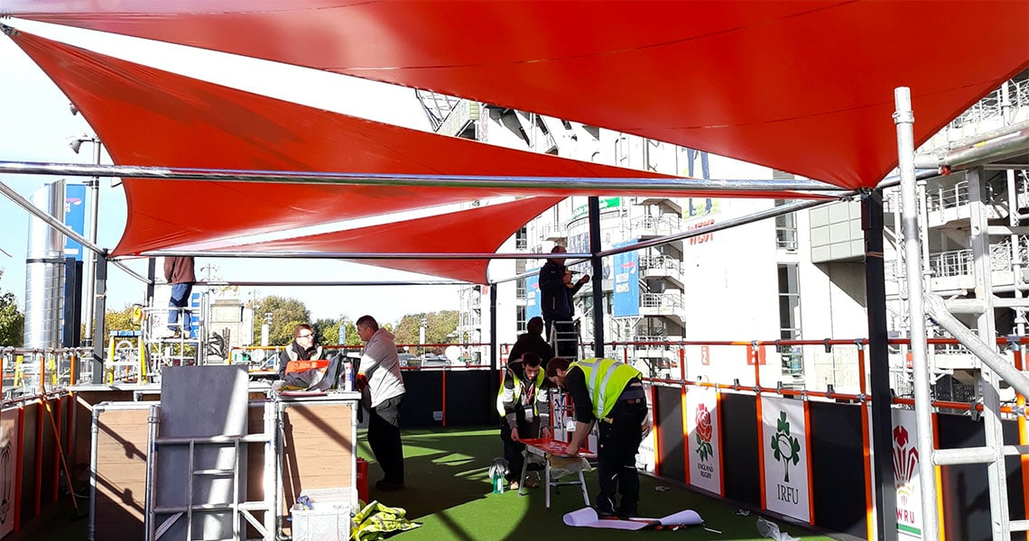 custom shapes red tensile canopies finishing process