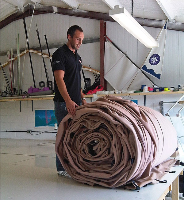SD Sails worker rolls up big stretch tent