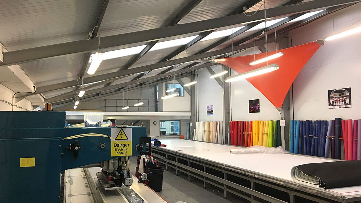 SD Sails workshop interior with fabrics and plotter